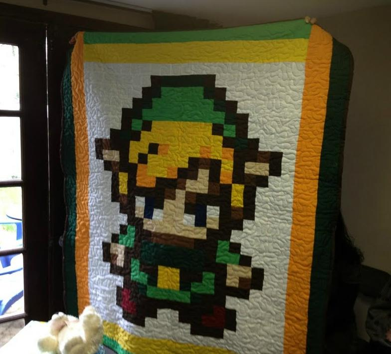 "Hand made baby blanket depicting ""The Legend of Zelda"" Link. Created pixel perfect and stitched by a loving gradmother"