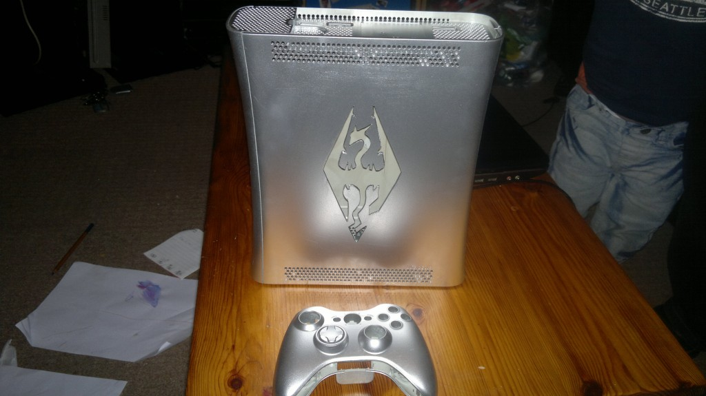 Silver Skyrim Dragon Logo custom cut xbox case and controller. Almost finished, needs a few final coats of paint